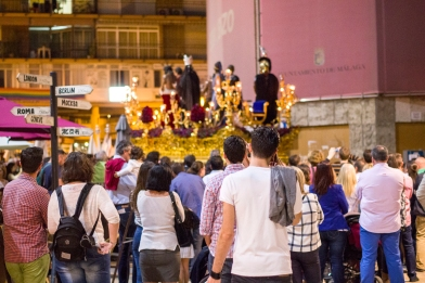Huge crowds gather, like this one in the Plaza de la Merced in Malaga, for every procession.