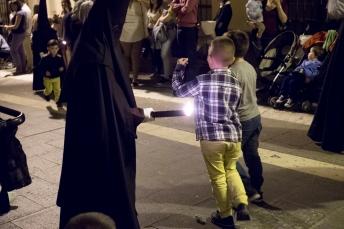 Children collect wax.