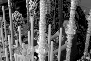 Workers inspect the candles in one of the floats during the morning of Good Friday (Viernes Santo).
