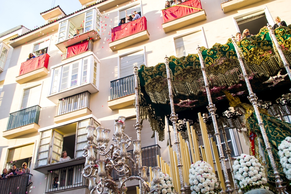 Residents throw petals from their windows and balconies as the floats go past.