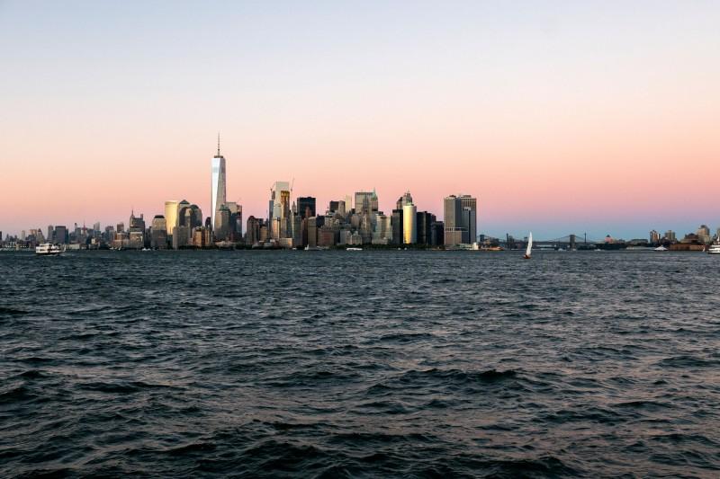 Manhattan skyline, pink skies.