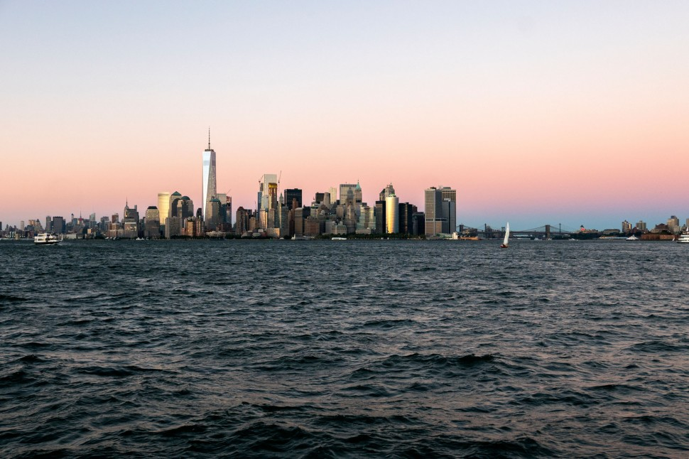 Manhattan skyline, pink skies.
